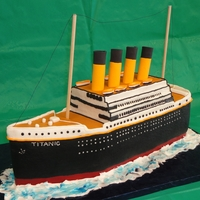 Titanic made from an 11x15 cake, all buttercream except for the smoke stacks. use wilton disposable supports covered in fondant.