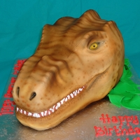 "Trex Head made from a 11x15 and a 6"" sq, ivory fondant then airbrushed."