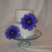 Blue Daisy Simple and small fondant covered cake with ribbon and silk flowers. Thank you for looking!
