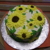Sunflowers butter cream piped sunflowers on the cake in no specific pattern