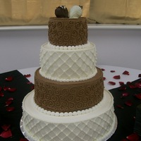 Coreyandmichelle chocolate and vanilla cake with chocolate covered strawberries and royal icing scrolls and pearls.