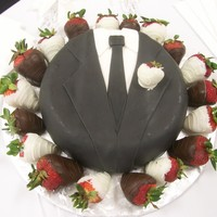 Corey New york style cheese cake covered with black vanilla and white vanilla fondant decorated like a tuxedo.