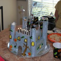 Haunted Castle  This is my son's b-day cake from last year. It's BC icing w/some fondant accents and a few royal icing premade accents. The...