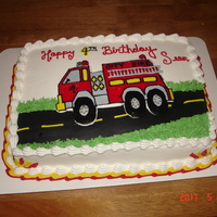 Fire Truck Cake   Fire Truck is made from a frozen buttercream transfer. Road is MMF.