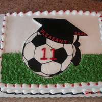 Graduation Cake   1 of 2 graduation cakes done for a friend's son. The soccer ball with graduation cap is a frozen buttercream transfer.