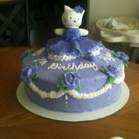 Hello Kitty Ballerina Cake I made for my niece. She wanted a purple ballerina, girly, hello kitty cake with little fondant.
