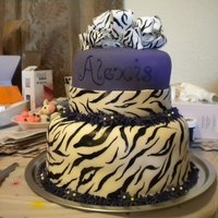 Zebra/purple Cake Made this cake for a Justin Bieber themed birthday party for a 7 year old. It is a two tiered chocolate cake with buttercream icing,...