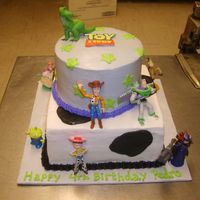 Toy Story  8-inch square on bottom, 6-inch top, marble cake w/ strawberry mousse filling (go figure?!). Customer supplied her kid's toys for the...