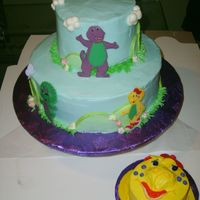 Barney & Friends - Bj Smash Cake  10 inch bottom tier, 6 inch top, 4 inch smash. The cake started to lien en route to customer's! I made an emergency pit stop at a...