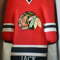 Chicago Blackhawks Hockey Jersey   Blackhawks hockey jersey 1/4 sheet cake. Covered in fondant, logo fondant.