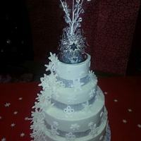 Four Tier Nine Layer White And Chocolate Cake Buttercream Filling With Buttercream Frosting Gumpaste Snowflakes Silver Cloth Mesh Rib *Four tier nine layer white and chocolate cake. buttercream filling with buttercream frosting. Gumpaste snowflakes. silver cloth mesh...
