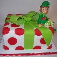 Christmas Elf   This is an almond pound cake, dressed up like a present, with an elf.