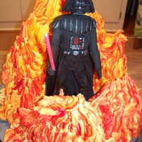 Darth Vader   This Darth Vader was made of gum paste and fondant. The cake was sculpted to look like flames and is covered in buttercream frosting.
