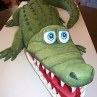 Big Gator   Alligator birthday cake - almond pound cake with vanilla/almond buttercream and Satin Ice fondant.