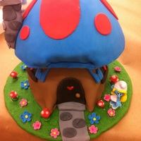 Smurf House Cake  Top cake is key lime. Bottom cake is pistachio both with lemon buttercream and decorated with fondant. Everything else is made from...
