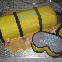 Scuba Tank And Mask Wedding Cake I mad this using an 11 x 15 and cutting it in half lengthwise ans stacking the layers. the mask was made from an 8`square and then both...