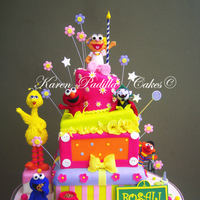 Sesame Street Cake/plaza Sesamo Cake Unique design by Karen Padilla for Rosali's 1st Birthday!.All sugar paste figures and hand painted, with a lot of amazing breght...