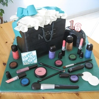 Makeup Cake Shopping bag and makeup bag are chocolate cake with chocolate buttercream covered in fondant. Everything from the bow, to the tissue, the...