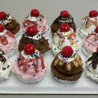 Ice Cream Sundae Chocolate cakes with scoops of either chocolate, vanilla or strawberry frosting. Drizzled with thinned chocolate, carmel or strawberry...