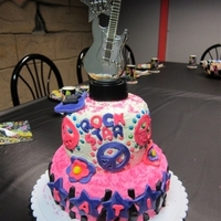 Rock Star Cake My daughter's 8th birthday cake. I used a conglomeration of ideas from this site. Used her party favors (peace sign necklace, guitar...