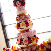 Enchanted Wedding Cake This is the cake that I made for my own wedding. We had a pink and gold theme with a love bird motif. This cake is very dear to me, and I...