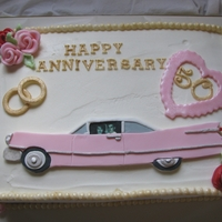 Pink Cadillac Anniversary Cake   Buttercream cake with fondant and gumpaste accents and edible image.