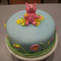 Pig In The Flowers  I made this cake for my husband's work. They asked for a cake and I wanted to practice so this is what they got. The cake is coconut...