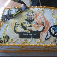 Rey Mysterio friend's son was into this wrestler. edible image of wrestler had an awesome pattern so I just echoed it on the cake sides. bc...