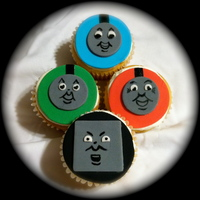Thomas Cupcakes Hand painted faces. Perfect for the worlds great fan