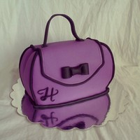 Purple Purse Cake   Red velvet cake and vanilla buttercream covered in fondant