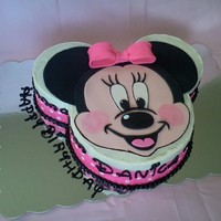 Minnie Mouse Cake Chocolate chip cookie cake with vanilla buttercream and fondant accents