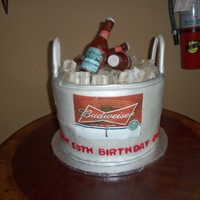 Beer Bucket Isomalt bottles and ice - cake was buttercream with edible images on cake and bottles.