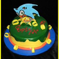 Sonic The Hedgehog Sonic the Hedgehog Birthday Cake. Sonic's rings are made of gumpaste, cake is decorated in fondant. TFL :D
