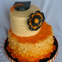 Shabby Chic Graduation Cake The graduate was a fashionista and her mom wanted something representing her style. I chose ruffles and a big flower, and used a ridged...