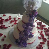 Purple/red Wedding I was asked to combine red/purple with a traditional style and a topper that was made by a family friend... the bride loved her cake. WASC...