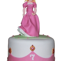 "Princess handmade figure on a 8"" cake"