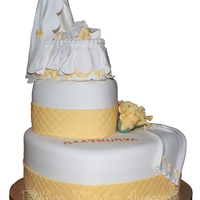 Christening Cake A christeningcake in white, yellow and gold. All decorations made of gumpaste. And the crib on top is made for the biggest FI mold of the...