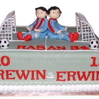 Brothers A soccer cake for two brothers birthdays. Hand modelled figures on top.