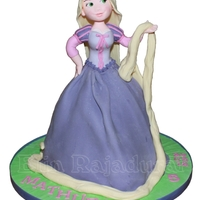 Rapunzel A standing Rapunzel princess cake. Hand modelled upper body and head.