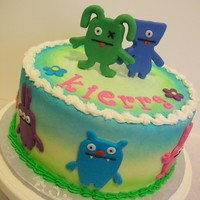 Ugly Dolls Simple 8 inch layer cake iced in buttercream and airbrushed. Fondant ugly dolls.