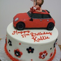 Mini Cooper 9 inch layer cake iced in buttercream with fondant flowers. Car was made of krispie treats covered in fondant.