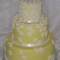 Yellow Daisy Yellow cake covered with small white fondant daisies.