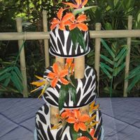 Zebra Print Zebra print with bamboo pillars. Gumpaste tiger lilies, silk birds of paradise and a gumpasste bird of paradise on top. Was done for a...
