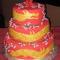 Red Dragon Red fondant cake with gold dragon wrapping from top to bottom. Cherry blossoms added in the extra space.