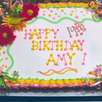 Happy Birthday Amy   1/2 sheet cake buttercream with happy colors, silk flowers. Many thanks to Cakery & others for your inspiration.