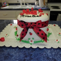 Ladybug Baby Shower Cake   I made this cake for a ladybug themed baby shower. The cake is covered in mmf with accents made with mmf.