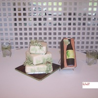 Wine & Cake Wine themed wedding cake. Grapes, wine bottle and crate are gumpaste. Cake is covered in MMF. Thanks for looking!