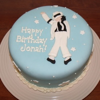 Michael Jackson Cake Three layers of dark chocolate cake with chocolate filling. (9 inch rounds)Decorated with blue MMF. Michael is made of MMF and black Satin...