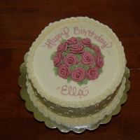 Pink Lady Three 9 inch rounds of vanilla cake with buttercream icing, borders, dots. The roses are white chocolate clay that I tinted pink and added...
