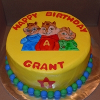 Alvin And The Chipmunks Ten inch round WASC with chocolate ganache filling and iced in buttercream. The chipmunks are painted with gel coloring and vodka on...
